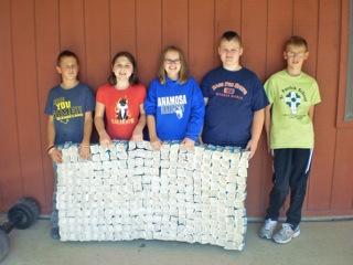 Students posing with the milk cartons wasted [photo]