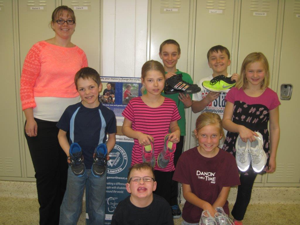 Children at South O'Brien Elementary show off their shoe collection [photo]