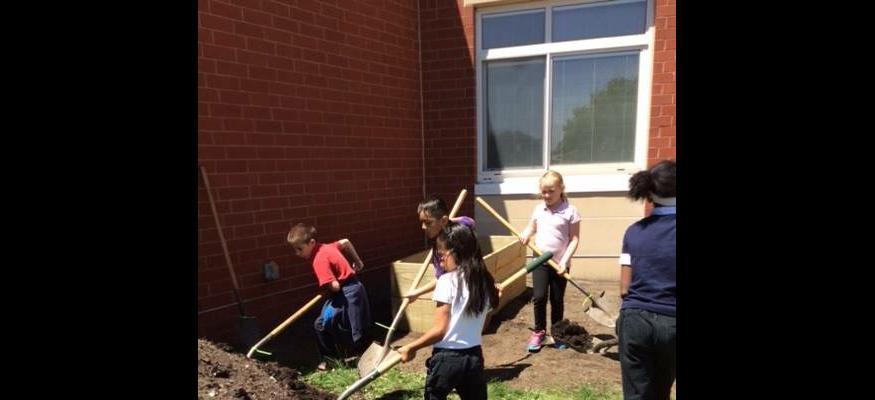 Highland Kids Moving Compost for Garden Beds