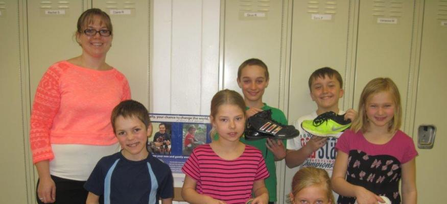 Students collect shoes